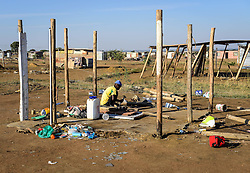 HAMMANSKRAAL, May 24, 2016 (Xinhua) -- A man tries to rebuild his shack in Hammanskraal, north of Pretoria, South Africa, on May 24, 2016. At least two people have been killed and six others injured during a violent protest in Hammanskraal, north of Pretoria, police said on Monday. The protest erupted on Monday when authorities tried to remove shacks that had been illegally built on a piece of land near a shopping mall, Pretoria Metro Police said. (Xinhua/Zhai Jianlan) (djj) (Credit Image: © Zhai Jianlan/Xinhua via ZUMA Wire)