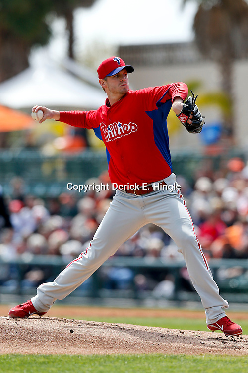 Mar 3, 2013; Sarasota, FL, USA; Philadelphia Phillies starting pitcher Kyle Kendrick (38) against the Baltimore Orioles during a spring training game at Ed Smith Stadium. Mandatory Credit: Derick E. Hingle-USA TODAY Sports