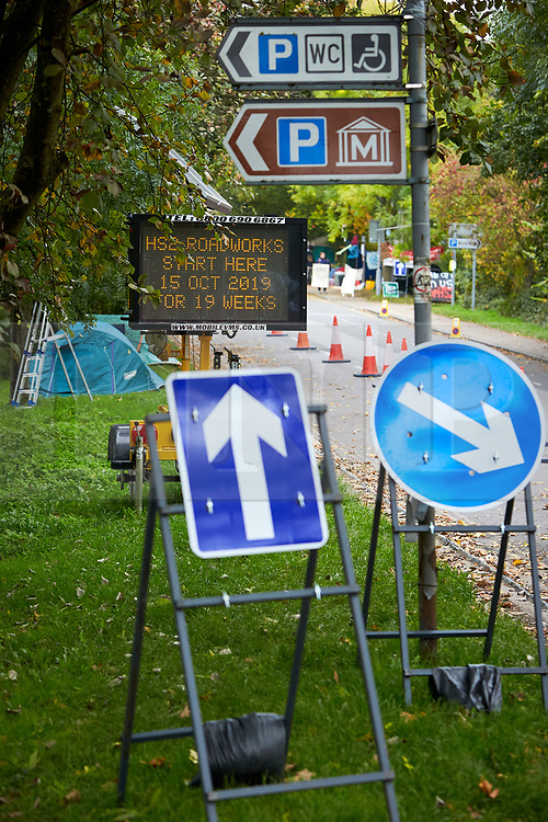 © Licensed to London News Pictures. 23/10/2019. GREAT MISSENDEN, UK.  Enabling works to allow the construction of the HS2 railway continue despite the future of the project being reviewed. A number of mature trees were due to be felled last week to allow easier access for construction traffic but local residents and climate activists created a makeshift camp to prevent their destruction. In this picture: Road sign on Link Road warning of 19 weeks of roadworks. Photo credit: Cliff Hide/LNP