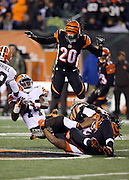 Cleveland Browns running back Ben Tate (44) gets tackled as he runs the ball in the third quarter while Cincinnati Bengals free safety Reggie Nelson (20) leaps over the pile while trying to assist on the tackle during the NFL week 10 regular season football game against the Cincinnati Bengals on Thursday, Nov. 6, 2014 in Cincinnati. The Browns won the game 24-3. ©Paul Anthony Spinelli