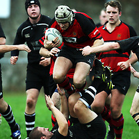 Mike Reid leaps over his opponent  during the Ennis V Cobh Rugby match in Ennis on Saturday .<br /> Photograph by Eamon Ward