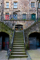 Old stairway leading to traditional tenement apartment building in Edinburgh Old Town, Scotland, UK