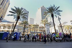 09 February 2016. New Orleans, Louisiana.<br /> Mardi Gras Day. Walking with Skeletons along Canal Street downtown. The Skeleton Krewe meet before sunrise and walk 5 miles from Uptown, making their way along St Charles Avenue and into the French Quarter where they celebrate Mardi Gras Day.<br /> Photo©; Charlie Varley/varleypix.com