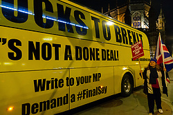 """A pro-Remain campaigner welcomes the arrival of a bus emblazoned with """"Bollox to Brexit"""" at Steve Bray's ongoing pro-remain protest at Old Palace Yard outside Parliament. Westminster, London, December 20 2018."""