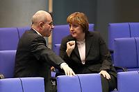 11 DEC 2003, BERLIN/GERMANY:<br /> Volker Kauder (R), CDU, 1. Parl. Geschaeftsfuehrer, und Angela Merkel (L), CDU, Bundesvorsitzende, im Gespraech, waehrend der Bundestagsdebatte zum EU-Verfassung, Plenum, Deutscher Bundestag<br /> IMAGE: 20031211-01-068<br /> KEYWORDS: Gespräch
