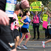 "NYTRUN - NOV. 6, 2016 - NEW YORK - Spectators holding signs including one which reads ""You Run Better Than Both Candidates"" cheer on runners in the 2016 TCS New York City Marathon as they pass through Central Park on Sunday afternoon. NYTCREDIT:  Karsten Moran for The New York Times"