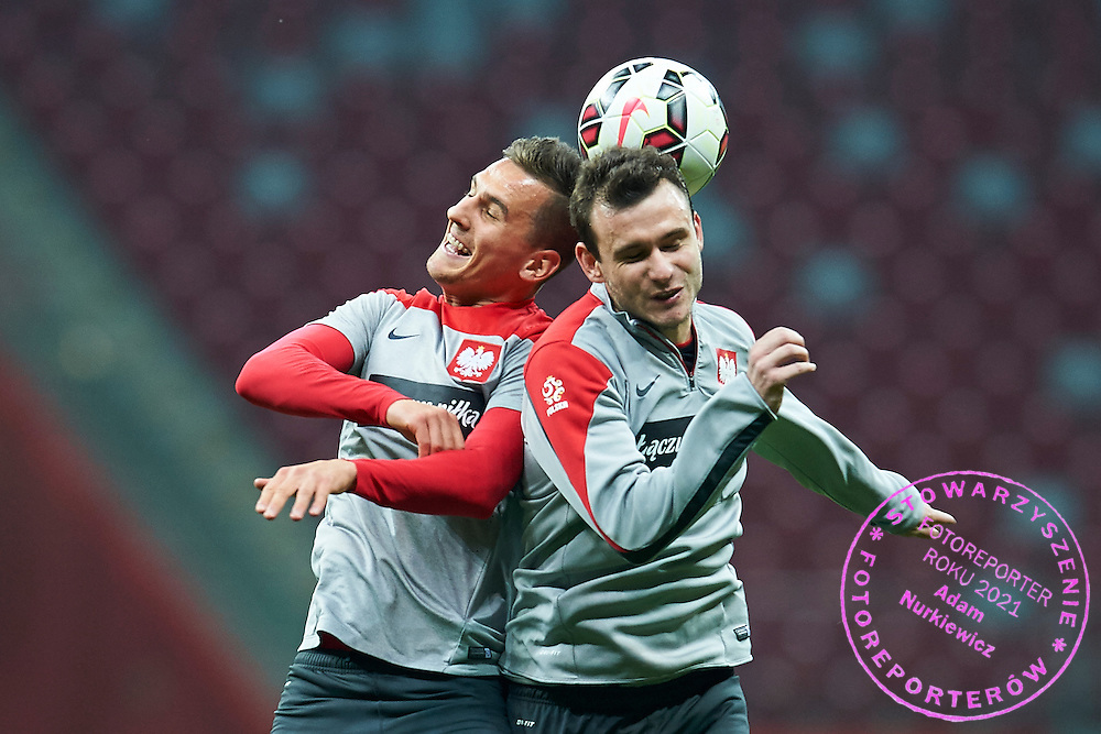 Poland's Arkadiusz Milik (L) fights for the ball with Poland's Filip Starzynski (R) during official training one day before the EURO 2016 qualifying match between Poland and Germany on October 10, 2014 at the National stadium in Warsaw, Poland<br /> <br /> Picture also available in RAW (NEF) or TIFF format on special request.<br /> <br /> For editorial use only. Any commercial or promotional use requires permission.<br /> <br /> Mandatory credit:<br /> Photo by &copy; Adam Nurkiewicz / Mediasport