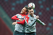 Poland's Arkadiusz Milik (L) fights for the ball with Poland's Filip Starzynski (R) during official training one day before the EURO 2016 qualifying match between Poland and Germany on October 10, 2014 at the National stadium in Warsaw, Poland<br /> <br /> Picture also available in RAW (NEF) or TIFF format on special request.<br /> <br /> For editorial use only. Any commercial or promotional use requires permission.<br /> <br /> Mandatory credit:<br /> Photo by © Adam Nurkiewicz / Mediasport