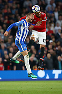 Chris Smalling of Manchester United  challenges Glenn Murray of Brighton during the Premier League match between Brighton and Hove Albion and Manchester United at the American Express Community Stadium in Brighton and Hove. 04 May 2018