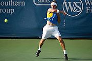 CINCINNATI, OH - AUGUST 18: Igor Andreev of Russia returns a shot to Gilles Simon of France during day two of the Western & Southern Financial Group Masters on August 18, 2009 at the Lindner Family Tennis Center in Cincinnati, Ohio. Simon defeated Andreev 7-6, 6-7, 6-4. (Photo by Joe Robbins)