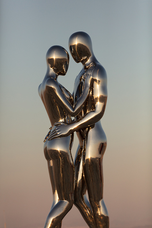 In Every Lifetime I Will Find You by: Michael Benisty, Love and Unity from: Brooklyn, NY year: 2018<br /> <br /> A sculptural representation of Male and Female holding one another in a symbolic and universal position of caring in a display of Love and Unity. Measuring 25 feet tall and made out of mirror polished stainless steel. My Burning Man 2018 Photos:<br />