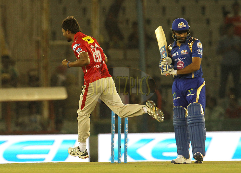 Kings XI Punjab player Sandeep Sharma celebrates the wicket of Mumbai Indians captain Rohit Sharma during match 21 of the Vivo Indian Premier League ( IPL ) 2016 between the Kings XI Punjab and the Mumbai Indians held at the IS Bindra Stadium, Mohali, India on the 25th April 2016<br /> <br /> Photo by Vipin Pawar / IPL/ SPORTZPICS