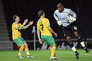 Milton Keynes - Tuesday, August 12th, 2008: Willy Gueret (R) of MK Dons saves Norwich City's Lee Croft shot as Jamie Cureton (L) looks on during the Carling League Cup First Round match at Stadium MK, Milton keynes. (Pic by Mark Chapman/Focus Images)