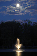 Middletown, New York - The full moon rises over the lake at Fancher-Davidge Park in Middletown on April 27, 2010.