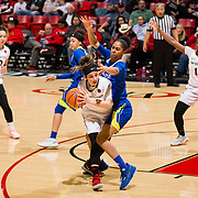 24 February 2018: The San Diego State women's basketball team closes out it's home schedule of the regular season Saturday afternoon against San Jose State. San Diego State Aztecs guard Geena Gomez (20) looks to pass the ball while being pressured by a Spartan defender in the second half. The Aztecs beat the Spartans 85-78 at Viejas Arena.<br /> More game action at sdsuaztecphotos.com