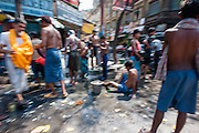 Men washing in Kolkata street (India).