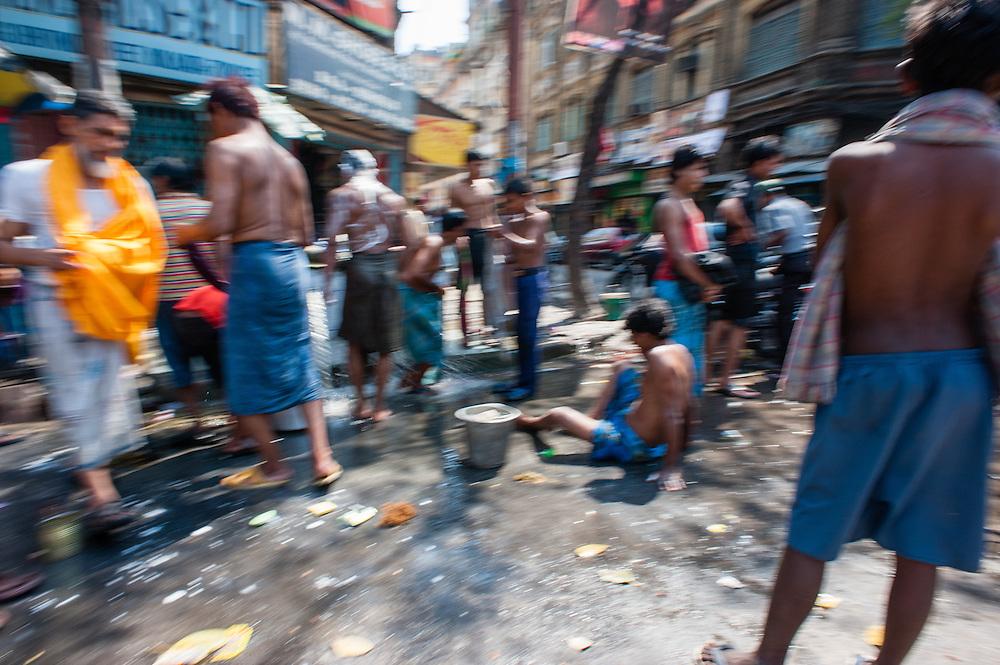 Men washing in Kolkata street (India).