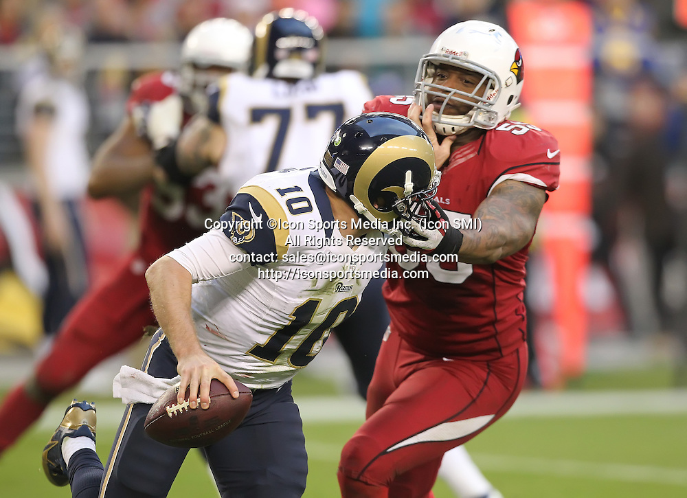 Dec 8 2013: Cardinals John Abraham (55) grabs Rams QB Kellen Clemens (10) during the Arizona Cardinals hosting the St. Louis Rams game in the University of Phoenix Stadium in Glendale, AZ.  The Cardinals defeat the Rams 30-10.