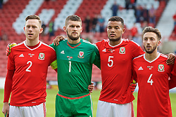WREXHAM, WALES - Friday, September 2, 2016: Wales' Gethin Jones, goalkeeper Billy O'Brien, Dominic Smith and Joshua Sheehan line-up for the national anthem before the UEFA Under-21 Championship Qualifying Group 5 match against Denmark at the Racecourse Ground. (Pic by Paul Greenwood/Propaganda)