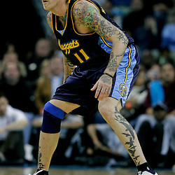 Dec 18, 2009; New Orleans, LA, USA;  Denver Nuggets center Chris Andersen (11) on defense during the second half against the New Orleans Hornets at the New Orleans Arena. The Hornets defeated the Nuggets 98-92. Mandatory Credit: Derick E. Hingle-US PRESSWIRE
