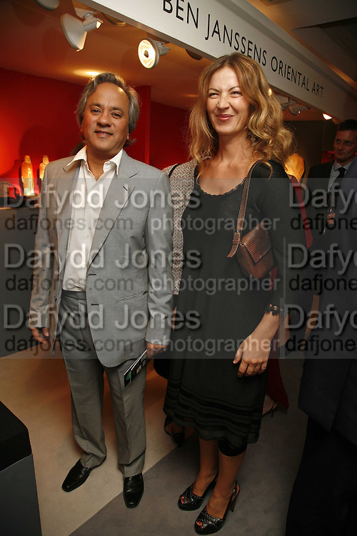 Anish and Suzanne Kapoor, Gala champagne reception and dinner in aid of CLIC Sargent.  Grosvenor House Art and Antiques Fair.  Grosvenor House. Park Lane. London. 14 June 2006. ONE TIME USE ONLY - DO NOT ARCHIVE  © Copyright Photograph by Dafydd Jones 66 Stockwell Park Rd. London SW9 0DA Tel 020 7733 0108 www.dafjones.com