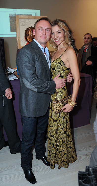 STASHA PALOS and TONY LEWIS at a reception to launch the Saatchi Opus held at the Saatchi Gallery, King's Road, London on 26th November 2009.