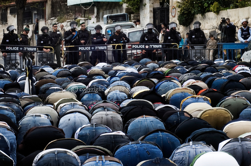 Palestinian Muslim worshippers perform Friday prayers outside Jerusalem's Old City on March 19, 2010 after they were banned from entering the Al-Aqsa Mosque compound due to Israeli police age restriction for men under 50-years-old in fear of riots at the holy site. The Quartet for the Middle East urged Israel to stop building settlements and set a bold target for a final deal with the Palestinians by 2012 as it tried to kickstart the stalled peace process. An Israeli announcement last week of the construction of 1,600 new settler homes in annexed east Jerusalem led the Palestinians to call for a halt to peace talks and precipitated the worst crisis in US-Israeli relations in years.© ALESSIO ROMENZI