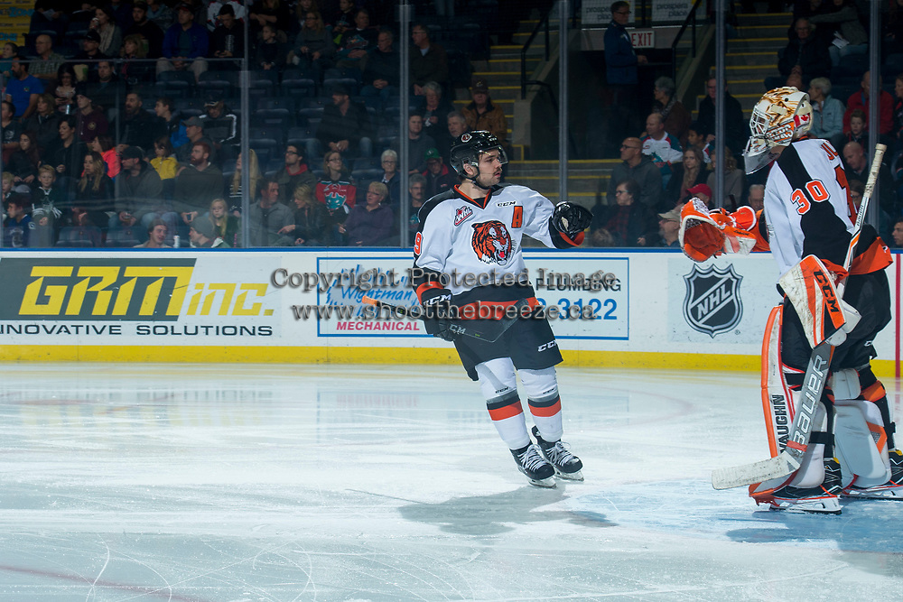 KELOWNA, CANADA - NOVEMBER 25: David Quenneville #19 fist bumps Michael Bullion #30 of the Medicine Hat Tigers at the start of the game against the Kelowna Rockets on November 25, 2017 at Prospera Place in Kelowna, British Columbia, Canada.  (Photo by Marissa Baecker/Shoot the Breeze)  *** Local Caption ***