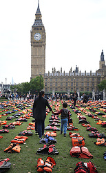 Parliament Square in London is transformed into a 'graveyard of lifejackets' using 2,500 lifejackets worn by refugees crossing from Turkey to the Greek island of Chios, during an event organised in support of refugees to coincide with the UN Migration Summit.