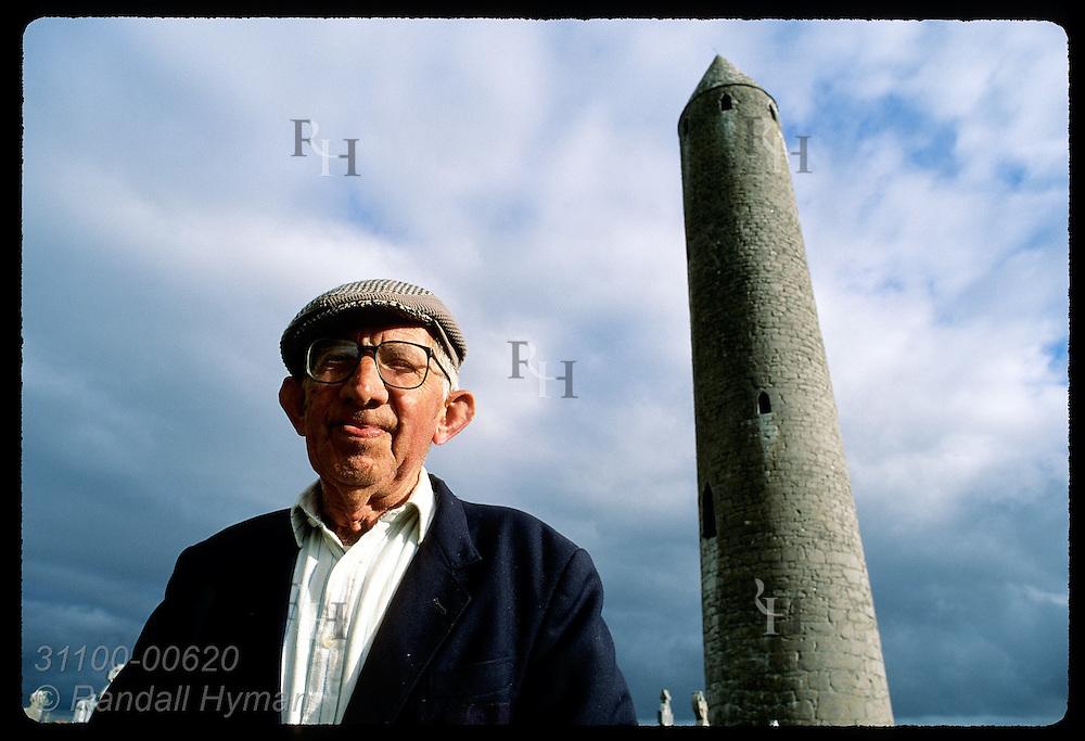 Caretaker Colman Finnegan & Kilmacduagh round tower (112'), site of St. Colman monastery; Gort. Ireland