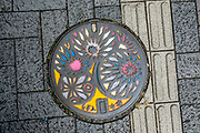Japanese manhole cover / hatchcover. Matsumoto, Nagano Prefecture, Japan.