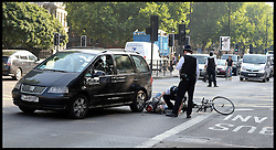 File picture of a Cyclist being hit by a Taxi on the Marylebone Road, London, United Kingdom. Friday, 23rd August 2013. Picture by Andrew Parsons / i-Images