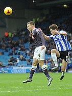 Sam Hutchinson of Sheffield Wednesday and Jason Shackell of Derby County go up forthe ball during the Sky Bet Championship match at Hillsborough, Sheffield<br /> Picture by Graham Crowther/Focus Images Ltd +44 7763 140036<br /> 06/12/2015
