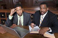 Two men sitting in court, portrait