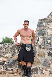 hot muscular man in a kilt outdoors