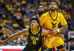 Dec 8, 2018; Morgantown, WV, USA; Pittsburgh Panthers guard Au'Diese Toney (5) blocks out West Virginia Mountaineers forward Esa Ahmad (23) during the second half at WVU Coliseum. Mandatory Credit: Ben Queen-USA TODAY Sports