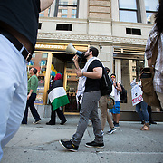Two groups, one of Palestinian supporters, and and another of supporters of Israel protest the recent events in Israel in front of the Israeli Consulate at 20 Park Plaza on July 11, 2014 in Boston, Massachusetts. (Photo by Elan Kawesch/The Times of Israel)