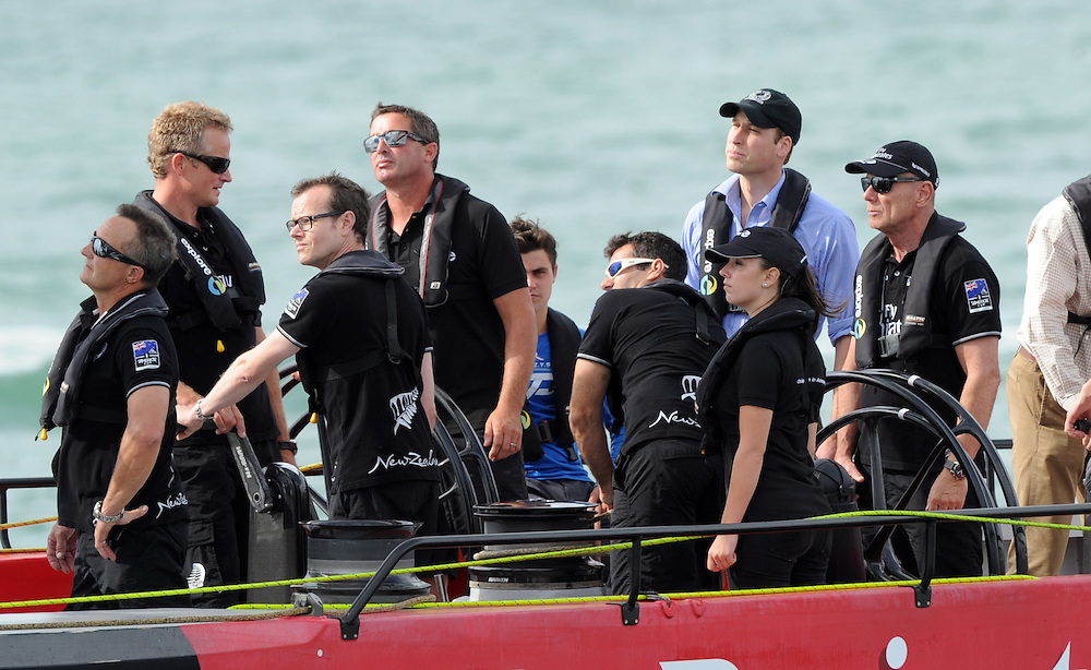 Britain's Prince William, blue shirt, looks to a rigging problem as he races an Americas Cup yacht against his wife, Catherine, Duchess of Cambridge on the Waitemata Harbour, Auckland, New Zealand, Friday, April 11, 2014. Credit:SNPA / Ross Setford
