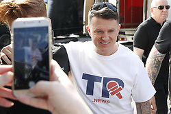 © Licensed to London News Pictures. 29/03/2019. London, UK. Tommy Robinson arrives in Whitehall as protestors gather outside Parliament as MPs debate the latest vote on the Withdrawal Agreement in the House of Commons. Photo credit: Peter Macdiarmid/LNP