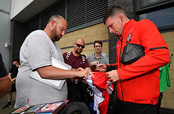 """Southampton's Pierre-Emile Hojbjerg signing a shirt during a pre season friendly match at Pride Park, Derby. PRESS ASSOCIATION Photo. Picture date: Saturday July 21, 2018. Photo credit should read: Anthony Devlin/PA Wire. EDITORIAL USE ONLY No use with unauthorised audio, video, data, fixture lists, club/league logos or """"live"""" services. Online in-match use limited to 75 images, no video emulation. No use in betting, games or single club/league/player publications."""