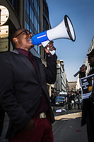 Brussels April 9 2015. A group of Congolese protesters in Brussels gathered in front of the RDC Congolese embassy. they asked for attention of the killed students in the university of Kenya and were angry all attention went to the Charlie Hebdo attacks and not to this terrorist attack. a massgrave found in maluku, next to kinshasha was another reason to protest against Kabila.Police protecting the embassy while a megaphone is used
