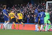 Wolverhampton Wanderers forward Raul Jimenez (9) scores a goal to make it 1-0 during the Premier League match between Chelsea and Wolverhampton Wanderers at Stamford Bridge, London, England on 10 March 2019.