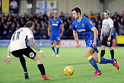 AFC Wimbledon defender Jon Meades (3) taking on Peterborough United attacker Marcus Maddison (11) during the EFL Sky Bet League 1 match between AFC Wimbledon and Peterborough United at the Cherry Red Records Stadium, Kingston, England on 12 November 2017. Photo by Matthew Redman.