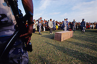 "Nepalganj, 01 March 2005... Policemen paying tribute to their colleague killed by Maoists the previous day. ""Our King Gyanendra is not the Rome's Emperor Nerone. He can't just sit in Kathmandu and watch Nepal burning... The Maoist principles are good, but the ways they threat people are wrong. They should act legally as a political party. We want peace, not war.."" an police officer says."