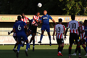 AFC Wimbledon striker Kweshi Appiah (9) winning header during the Pre-Season Friendly match between AFC Wimbledon and Brentford at the Cherry Red Records Stadium, Kingston, England on 5 July 2019.