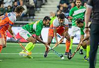 AMSTELVEEN - Terrance Pieters (Ned) met Rashid Mehmood (Pak) en Ali Rizwan     tijdens  de tweede  Olympische kwalificatiewedstrijd hockey mannen ,  Nederland-Pakistan (6-1). Oranje plaatst zich voor de Olympische Spelen 2020.   COPYRIGHT KOEN SUYK