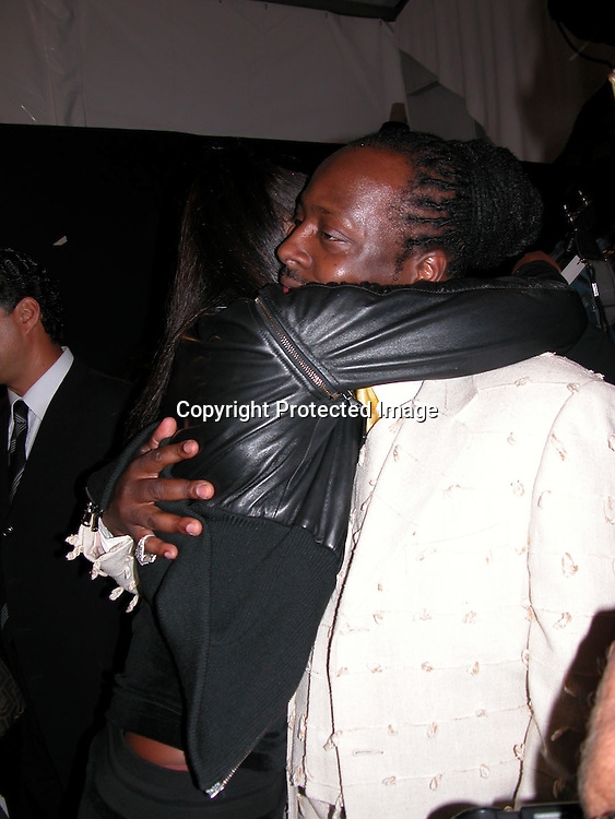 Naomi Campbell &amp; Wycleaf Jean <br />