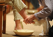 A parishioner washes the feet of another person during a Holy Thursday Mass. (Sam Lucero photo)