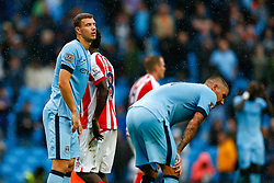 Edin Dzeko of Manchester City looks dejected after Stoke City win the match 0-1 - Photo mandatory by-line: Rogan Thomson/JMP - 07966 386802 - 30/08/2014 - SPORT - FOOTBALL - Manchester, England - Etihad Stadium - Manchester City v Stoke City - Barclays Premier League.