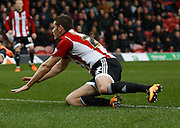 Brentford defender Jack O'Connell watches his header during the Sky Bet Championship match between Brentford and Derby County at Griffin Park, London, England on 20 February 2016. Photo by Andy Walter.